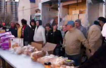volunteers prepare to distribute food to hungry