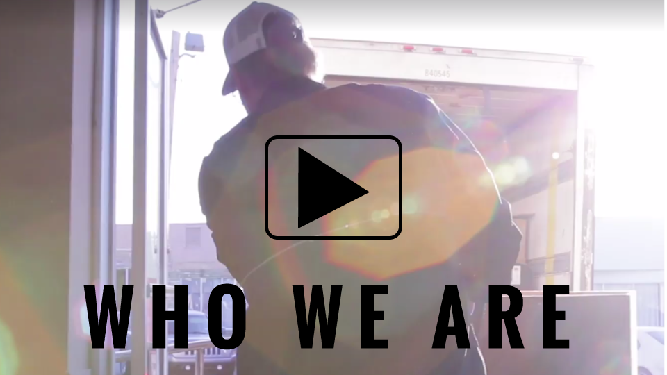 who we are video man loading box on truck